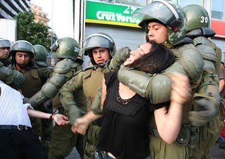 Mapuche woman being arrested